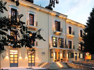 Helmos Hotel - Exterior View at Night