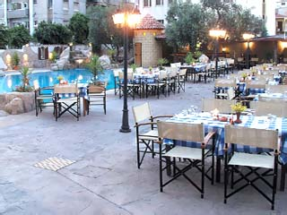 Cleopatra HotelLoucoullos Taverna by the Swimming Pool