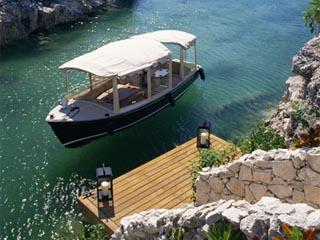 Rosewood MayakobáLuxury Boat on Lagoon