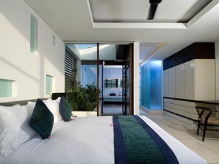 Aqua VillaFirst Bedroom