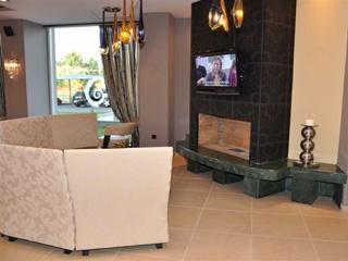 Amalias Hotel: TV Lounge