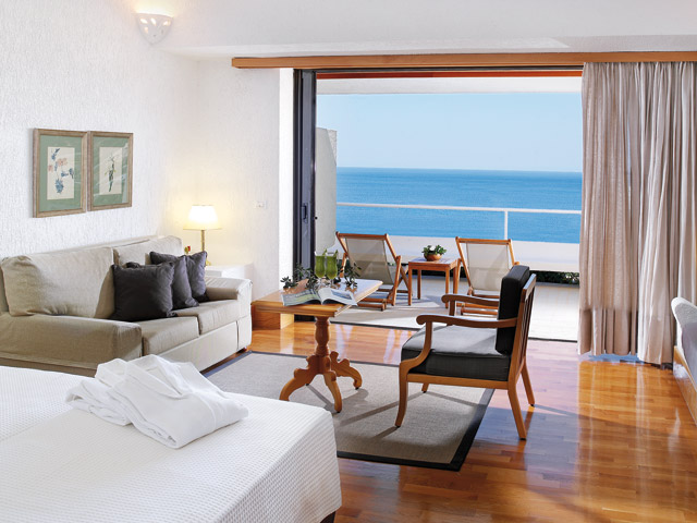 Porto Elounda Golf and SPA Resort - Seafront Bungalows Living Room & Bedroom